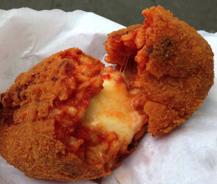 Rome's favourite street snack - Suppli from 00100 Pizzain the Testaccio area. These fried stuffed balls ooze risotto goodness made with bolognese sauce and stringy mozzarella. (Credits: Eating Food Italy Tours)