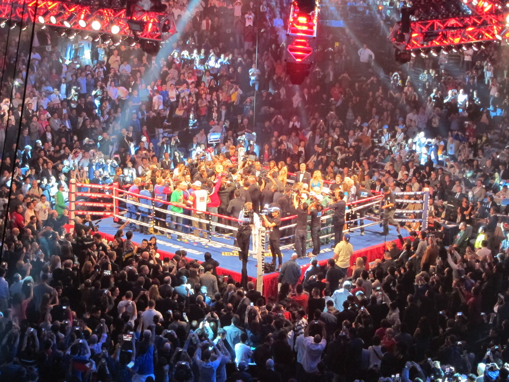 Pacquiao celebrating in the ring after the Brandon Rios fight. Not a bad view for the cheapest ticket.
