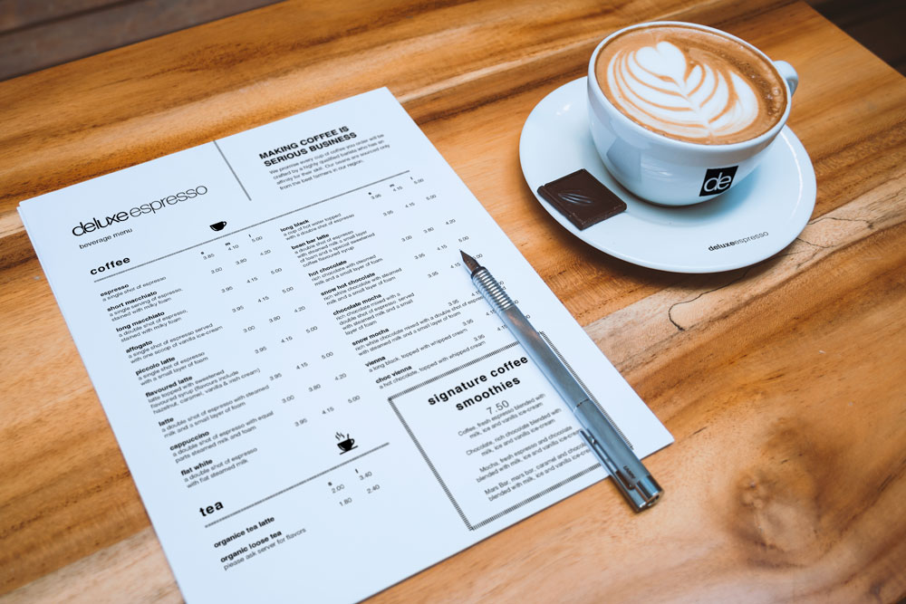 deluxeespresso_A4-Letterhead-and-Coffee-Cup-Mockup.jpg