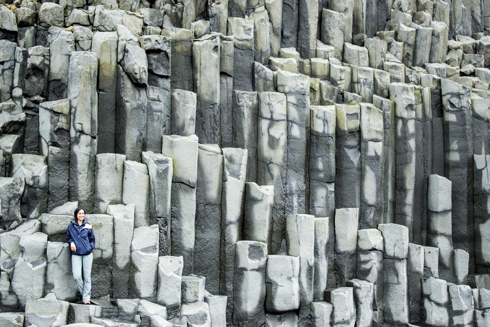 Reynisfjara Beach, Vík. These jagged basalt columns line the black sand beach for a dramatic photoshoot background.