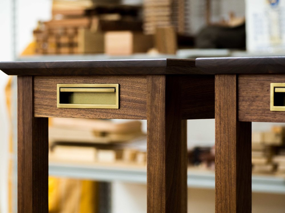 Nick's stools in Black Walnut with Brass details.
