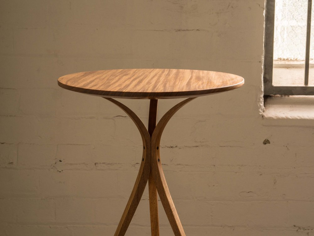 Keith's occassional table with twin tapered laminated legs.
