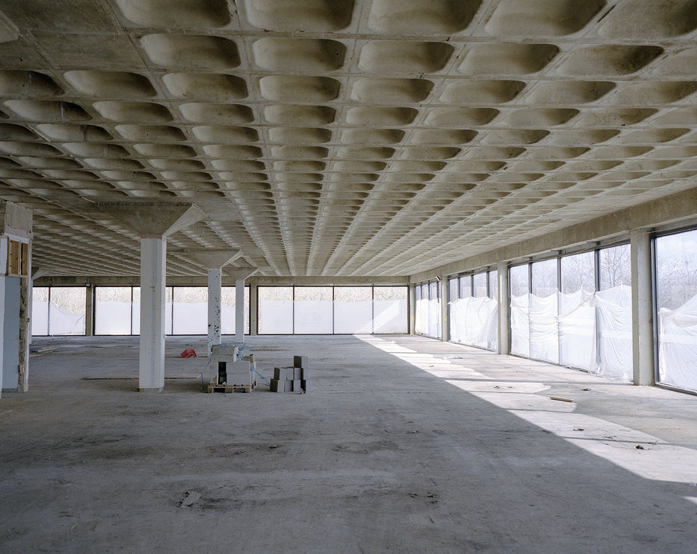 These images are from the inside Milton Keynes's first shopping units. The developer thought they were ripe for demolition and was ready to build new out of town style stores in their place.