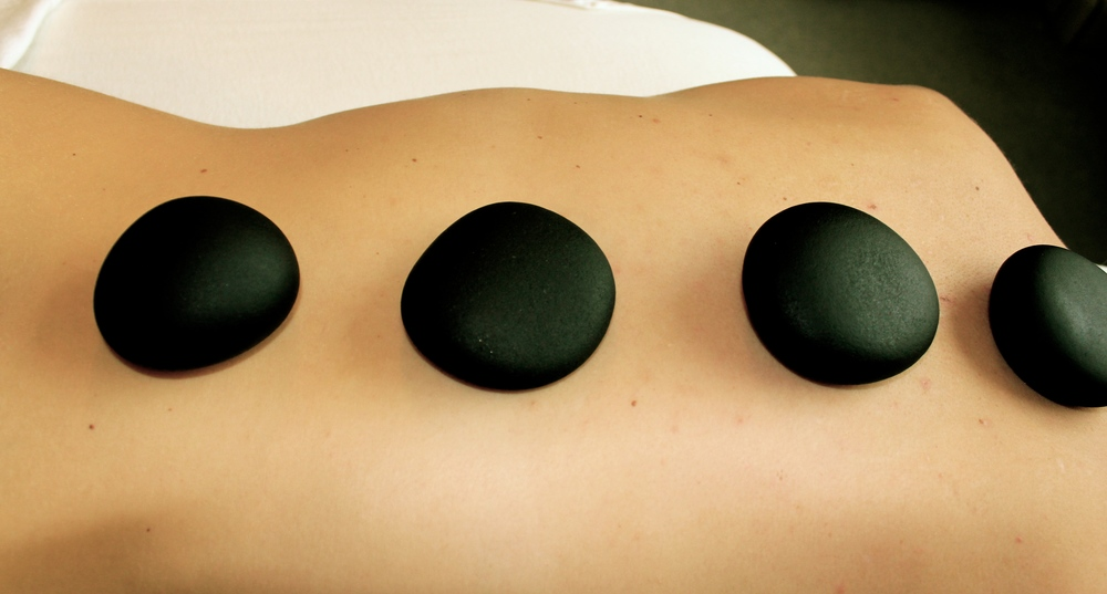 Hot stone massage, Odder