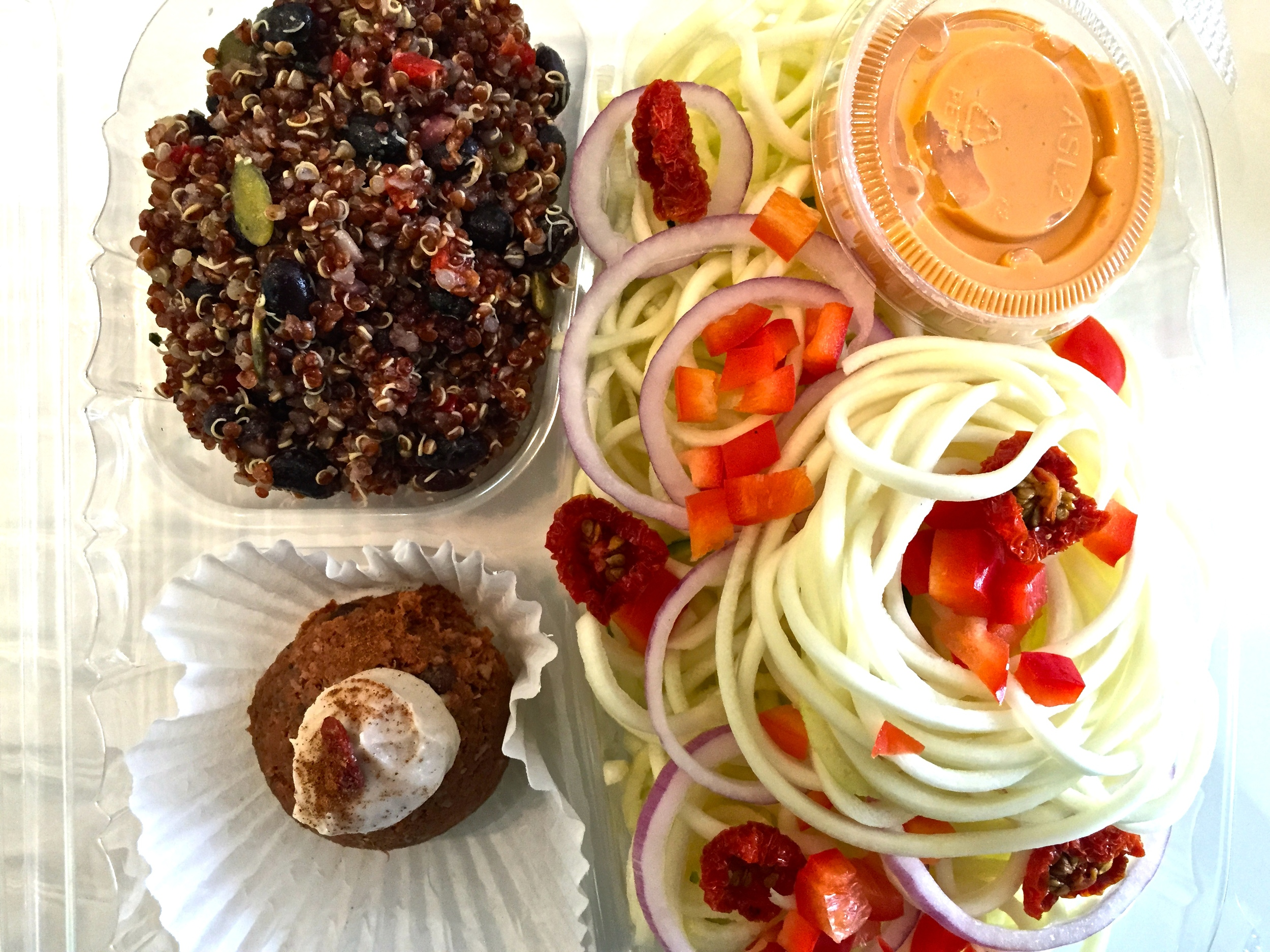 "Spaghetti: Zucchini Noodles, Raw Cashew Cheese Sauce, Signature Tomato ""raisins"" Quinoa: Quinoa, Black Beans, Cilantro, Lime Juice, Sea Salt, Red Onion, Bell Peppers, Cranberries, Pumpkin Seeds Carrot cake: I have no idea. But if I had to guess, I would say carrots."
