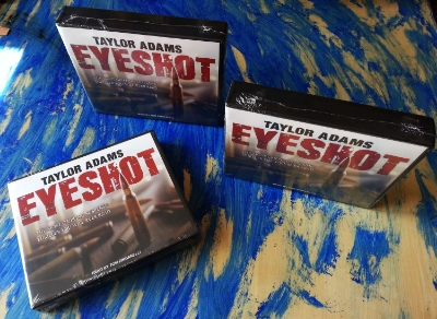 http://www.amazon.com/Eyeshot/dp/B00VVUAALM/ref=tmm_aud_swatch_0?_encoding=UTF8&sr=&qid =   http://www.amazon.co.uk/Eyeshot-Taylor-Adams/dp/1494561565/ref=tmm_abk_title_0?ie=UTF8&qid=1408735736&sr=8-1   James and Elle Eversman are a young couple traveling through the Mojave desert on their way to a new life. When their car mysteriously breaks down, they are stranded in the middle of nowhere without much water and no cell phone reception.  A mile away a deadly sniper has them in his crosshairs. They are pinned down behind their broken-down car, surrounded by open ground in all directions. There's nowhere to run and no one to help them. How can they possibly survive?  With relentless tension, razor-sharp prose, and a surprising dose of dark humor,  Eyeshot  will keep you gripped until its stunning conclusion.