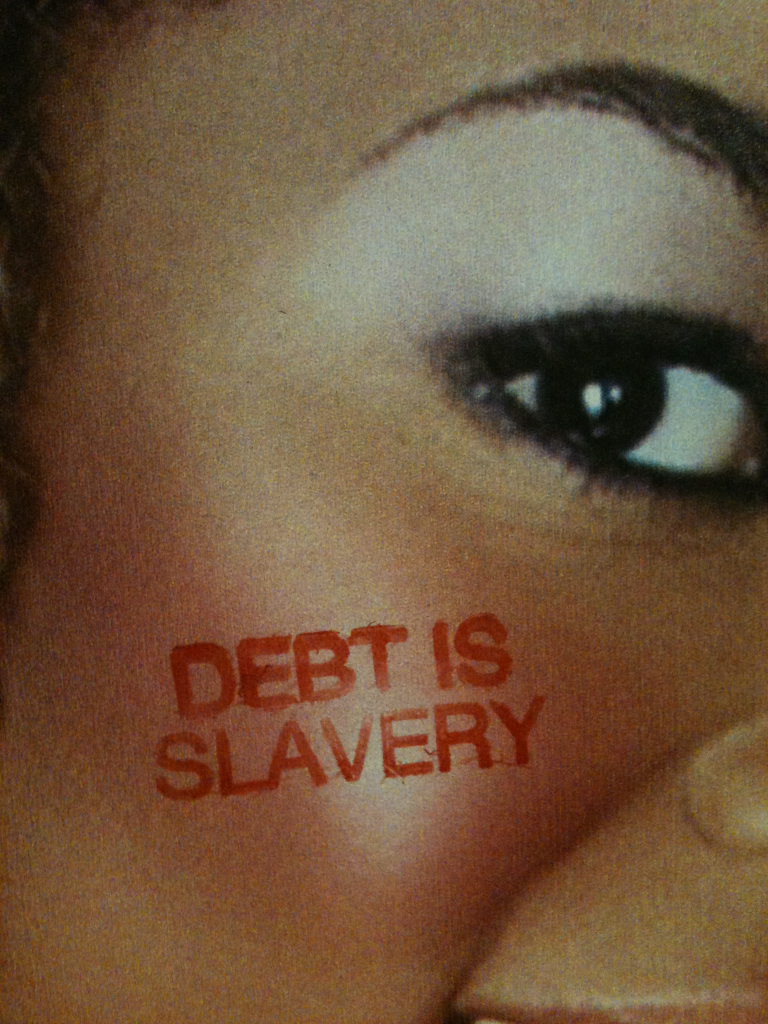 """DEBT IS SLAVERY"""