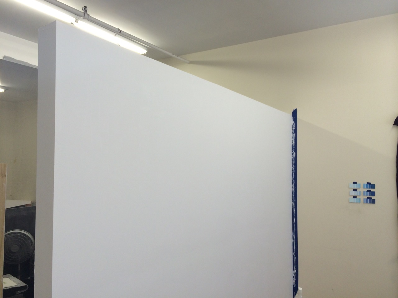 "New wall in the studio. (Also on view to the right there, ""Blue Chip Art."")"