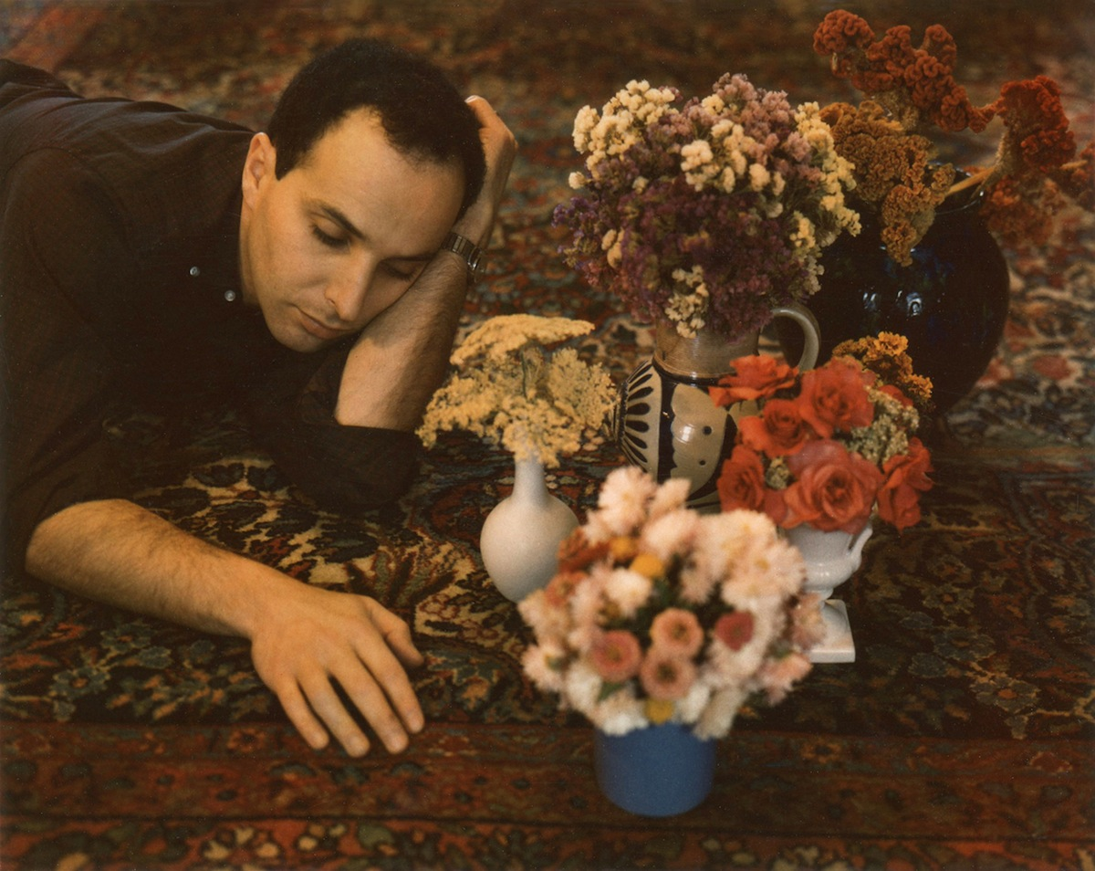 "blakegopnik: THE DAILY PIC:  This is ""Nathan with Floral"", a Polaroid shot in 1962 or 63 by Marie Cosindas, and now in an eye-opening survey of similar works by her that closes in a few days at Bruce Silverstein Gallery in New York. Cosindas found some success in the 1960s and '70s, thanks in part to support from John Szarkowski at MoMA (he gave her a solo there in 1966), then seems to have been mostly written out of photographic history.  What amazes me is that, among the rigors of Greenbergian abstraction, Minimalism and Conceptualism, the 1960s art world could also find room for Cosindas's wonderfully fussy, decorative, retrospective and frankly camp sensibility. The camp part strikes me as especially important: I'm fairly certain that ""Nathan"" in this photo is Nathan Gluck, a gay assistant working in the openly queer environment of Warhol's studio. (Cosindas also photographed Warhol himself, more than once, including for her ""Dandies"" series; like Warhol, and Gluck, she got her start amid the frippery of commercial art.) Gay culture of the '60s helped break open the boundaries of what kinds of art could count as acceptably avant-garde – absurd prettiness was allowed to challenge capital-B Beauty – and some female artists, such as Cosindas, could play a part in the shift.  The truth is, Cosindas's aesthetic is more radically anti-modern than anything you'll find even in Warhol, whose style, at its most cockeyed and queer, is still built on a backbone of Modernist rigor. (© Marie Cosindas, courtesy of Bruce Silverstein Gallery, NY)"