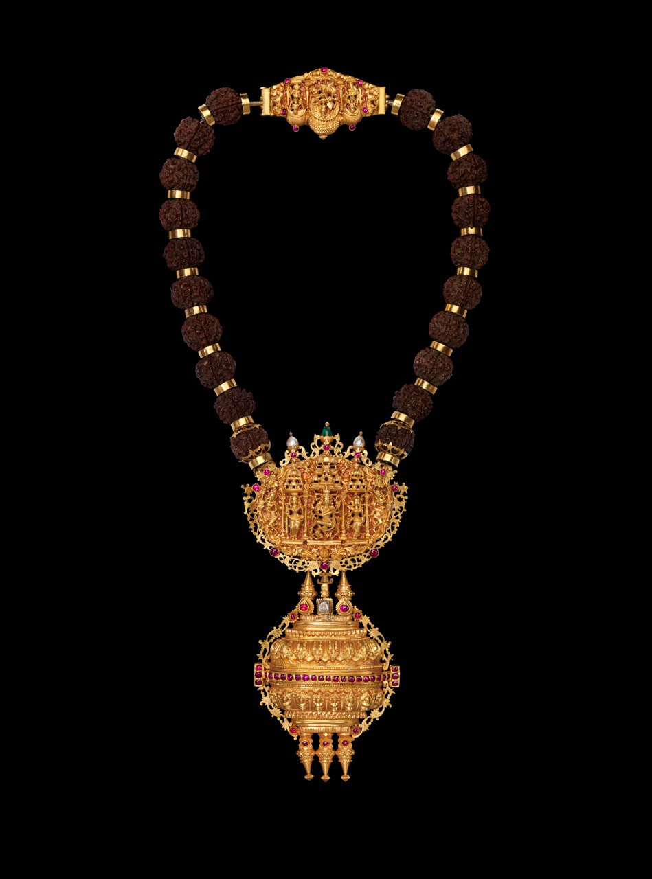 wildcat2030: ethnoarte: A priest's necklace depicting Shiva Nataraja, Kartikaya and attendants (Linga padakka muthu malai, or Gowrishankaram) 22 Karat Gold, silver, diamonds, rubies, pearls, rudraksha seeds and pink foil India, Tamil Nadu Early 19th c. Length: 19 inches (47 cm.) As a symbol, Shiva Nataraja is a brilliant invention. It combines in a single image Shiva's roles as creator, preserver, and destroyer of the universe and conveys the Indian conception of the never-ending cycle of time. Although it appeared in sculpture as early as the fifth century, its present, world-famous form evolved under the rule of the Cholas. Shiva's dance is set within a flaming halo. The god holds in his upper right hand the damaru (hand drum that made the first sounds of creation). His upper left hand holds agni (the fire that will destroy the universe). With his lower right hand, he makes abhayamudra (the gesture that allays fear). The dwarflike figure being trampled by his right foot represents apasmara purusha (illusion, which leads mankind astray). Shiva's front left hand, pointing to his raised left foot, signifies refuge for the troubled soul. The energy of his dance makes his hair fly to the sides. The symbols imply that, through belief in Shiva, his devotees can achieve salvation. (see more ) - Kartikeya, the second son of Lord Shiva and Goddess Parvati or Shakti, is known by many names Subramaniam, Sanmukha, Shadanana, Skanda and Guha. In the southern states of India, Kartikeya is a popular deity and is better known as Murugan. He is an embodiment of perfection, a brave leader of god's forces, and a war god, who was created to destroy the demons, representing the negative tendencies in human beings. More / More