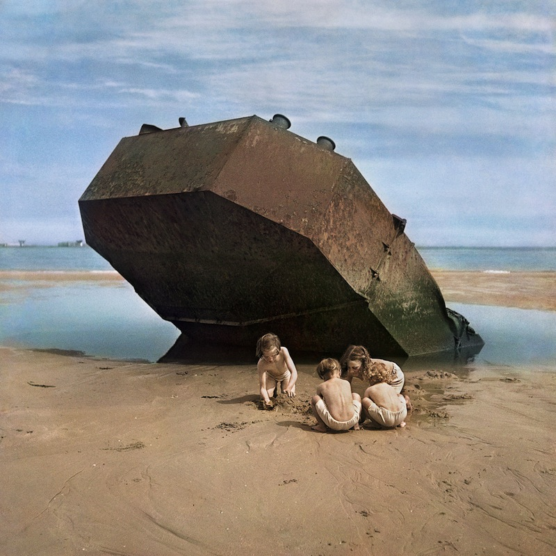 "blakegopnik: DAILY PIC: This fabulous and iconic picture, by the great photojournalist known as Chim, was taken in 1947 on Omaha Beach, in Normandy, where massive slaughter had been seen just a few years before. It's now in a show called ""We Went Back: Photographs from Europe 1933-1956 by Chim"", at the International Center of Photography in New York. This is just about the most lyrical image that Chim ever shot, and there's something especially great about his rare use of color film for it. We mostly think of this era, and its horrors, as having happened in black and white, so it's lovely that an image of recovery should glow, Oz-like, in soft polychrome. For a full visual survey of past Daily Pics visit blakegopnik.com/archive. The Daily Pic can also be found at the bottom of the home page of thedailybeast.com, and on that site's Art Beast page."