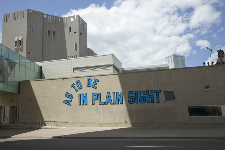 museumuesum :       Lawrence Weiner        AS TO BE IN PLAIN SIGHT,  2009   Powder-coated aluminum    Installation view at Denver Art Museum, Denver, Colorado