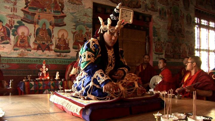rmanyc: Khyentse Yangsi Rinpoche performing a vajrayana ritual. http://on.fb.me/R5iqOP For a second I thought that clock was attached to his head…