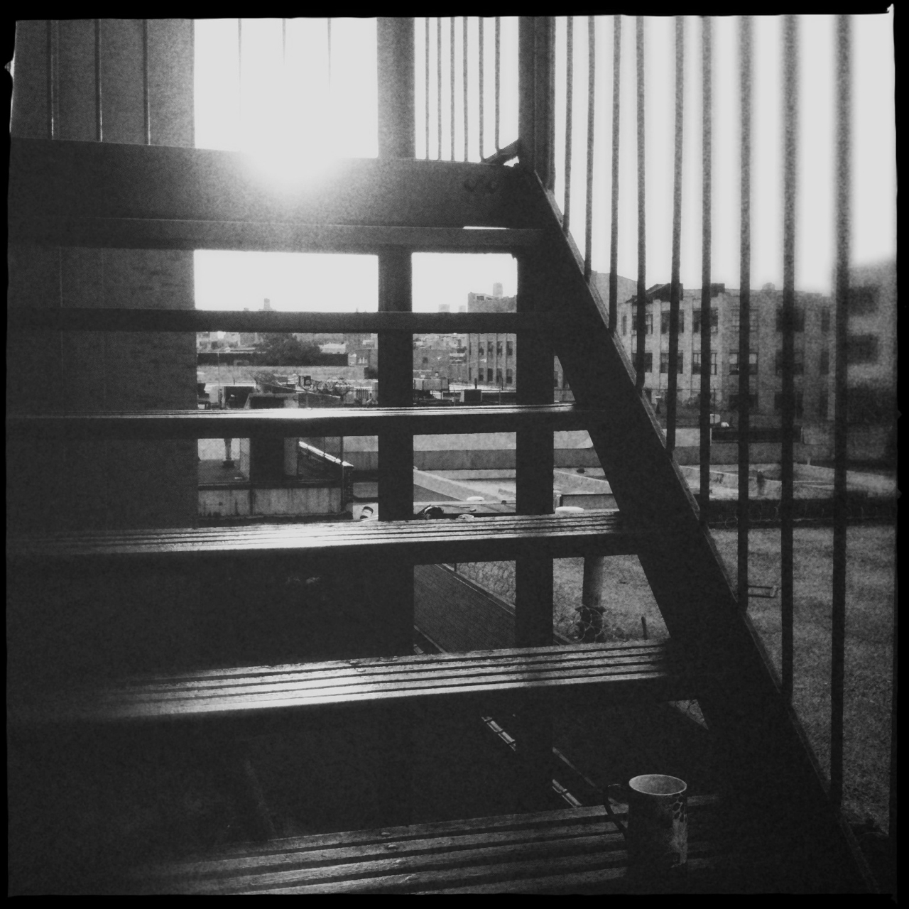 Studio fire escape.     AKA a spot for long phone calls and coffee on sweet late summer afternoons in Brooklyn.    Related, using Hipstamatic these days. Gonna try to shoot in only b&w for a while…