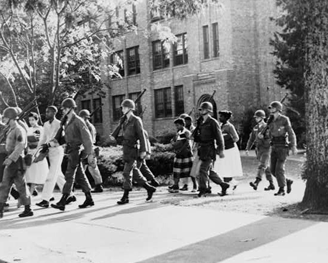 "pbsthisdayinhistory: Tuesday, Sept 4: ""Little Rock Nine"" Denied Entrance to School On this day in 1957, the ""Little Rock Nine,""  a group of African American high school students, unsuccessfully attempted to pass through angry crowds to integrate Central High School in Arkansas. Governor Orval Faubus had called out the National Guard to prevent them from entering the school. Later that month, the students finally were able to enter the school under the protection of paratroopers dispatched by President Dwight Eisenhower. Explore American Experience's photo gallery from the southern school desegregation years of 1957-1962. Photo: U.S. Troops escort African American students from Central High School, Little Rock, Arkansas on October 3, 1957 (Library of Congress). meanwhile, not that long ago…"