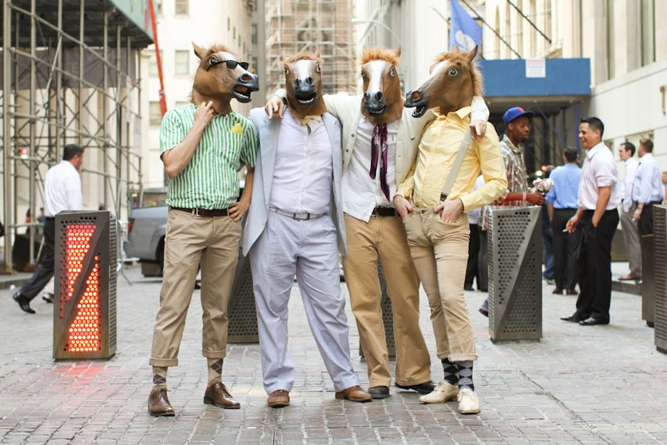 humansofnewyork: Not sure I can think of a better caption than a simple description: Four horse-headed people found on Wall Street.  The four horse men of the wallpocalypse!