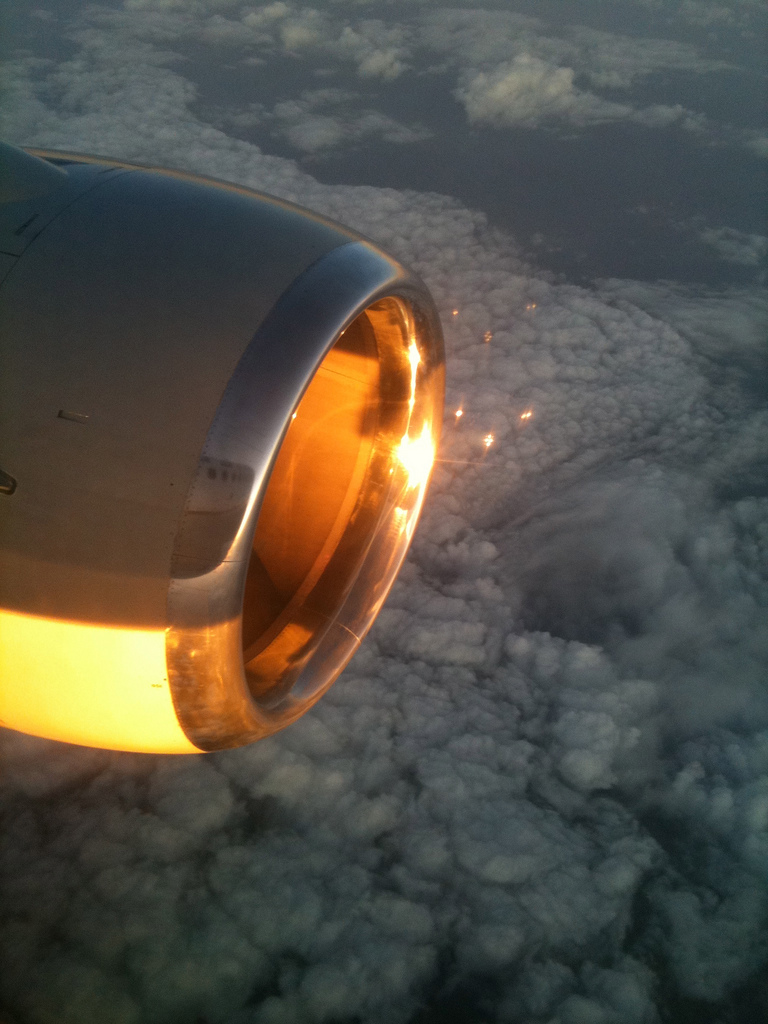 """Sunset striking jet engine at 35,000 feet"" (photo by  Jack Vinson )   Love this photo. And it was taken with an iPhone, no less. I especially dig those little gold reflections that are forming a sort of smiley face constellation.   It also reminded me of that famous Eggleston photo from 1970, which I'm told is going to be in  September 11  at MoMA PS1 next month. »"