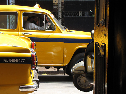 "Taxis in Kolkata .   About a year ago I landed in India from Thailand. That seems like a lifetime ago. Not sure what this has to do with oil or art or ""Work of Art"" or anything. Something about time away. I wish I was away. I wish I was here. I am… At the brink. Wishing I was everywhere and nowhere…"