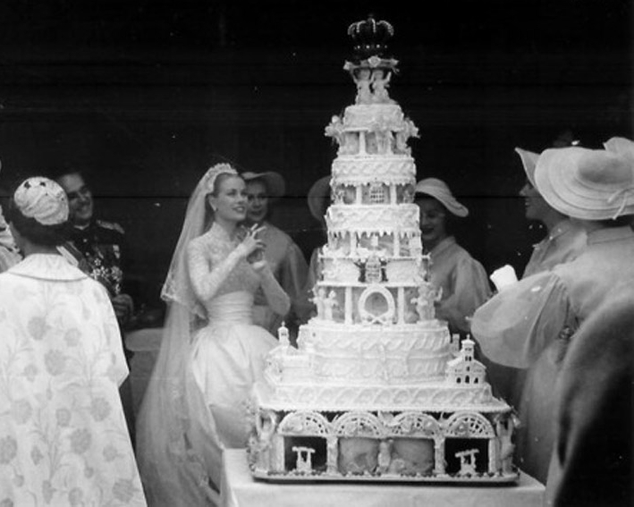 Princess Grace of Monaco at her wedding, with a cake to behold!