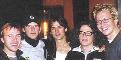 Grant (right) with Our Lady Peace band members