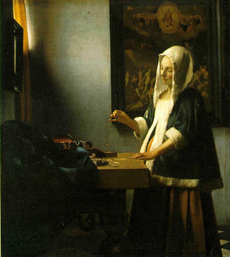 A Woman Holding a Balance by Johannes Vermeer