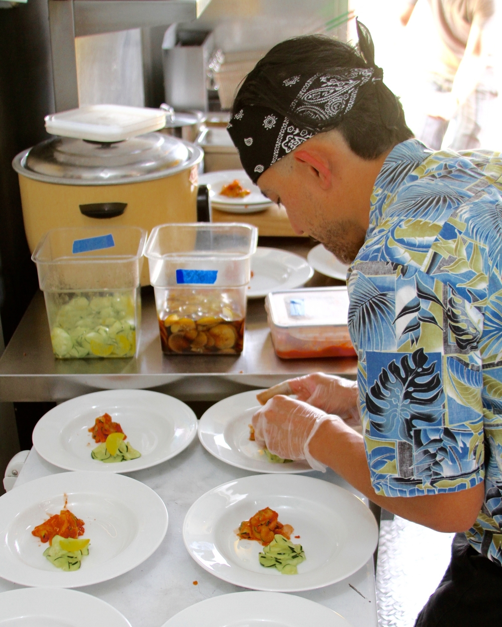 Portioning the cucumber salads