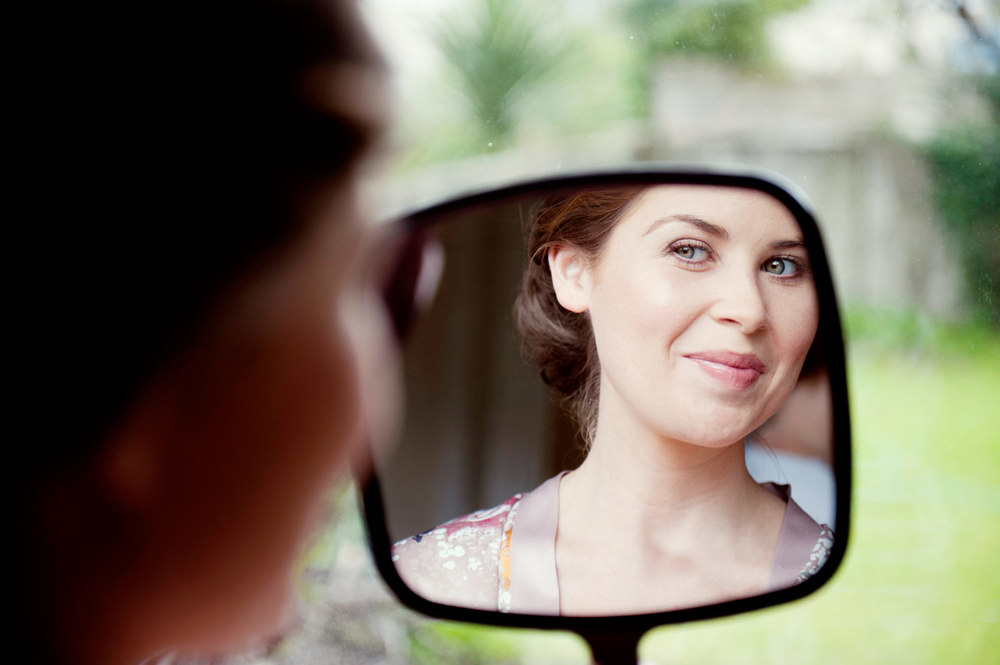 woman holding hand mirror. Bride Looks At Herself In Hand Held Mirror Dublin Ireland Wedding Photography Woman Holding