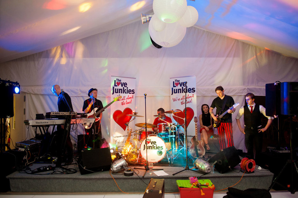 """Our wedding band was the Love Junkies who had the floor rocking all night."""