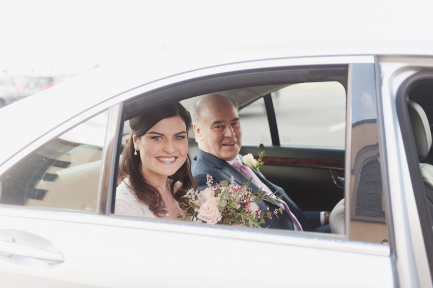 Father of the bride and bride in car on the morning of the wedding