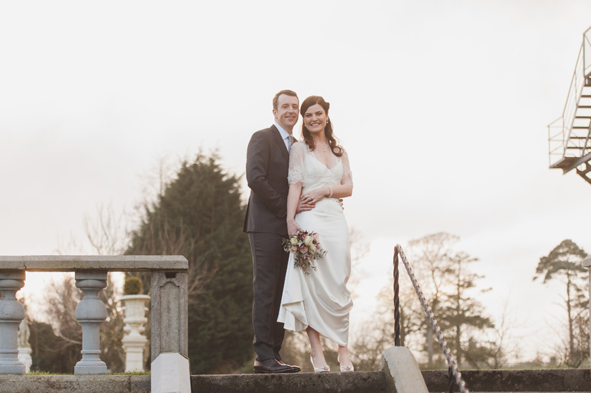 Bride and groom in Bellingham Castle Louth by sunset