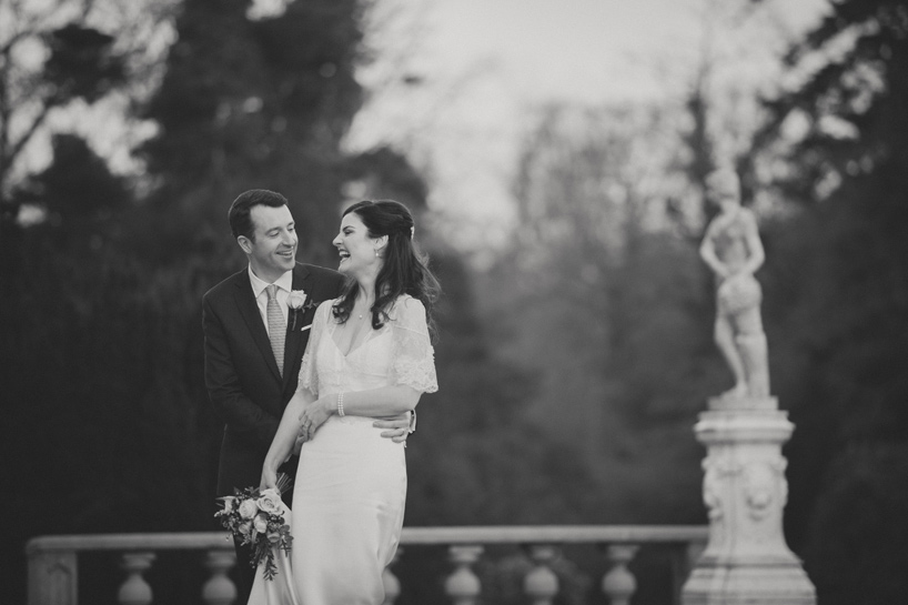 Bride and groom laughing together in Bellingham Castle Hotel Louth