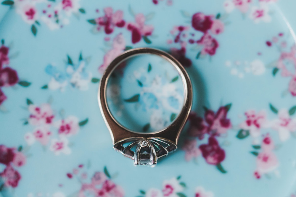 Wedding ring on a blue and pink floral background
