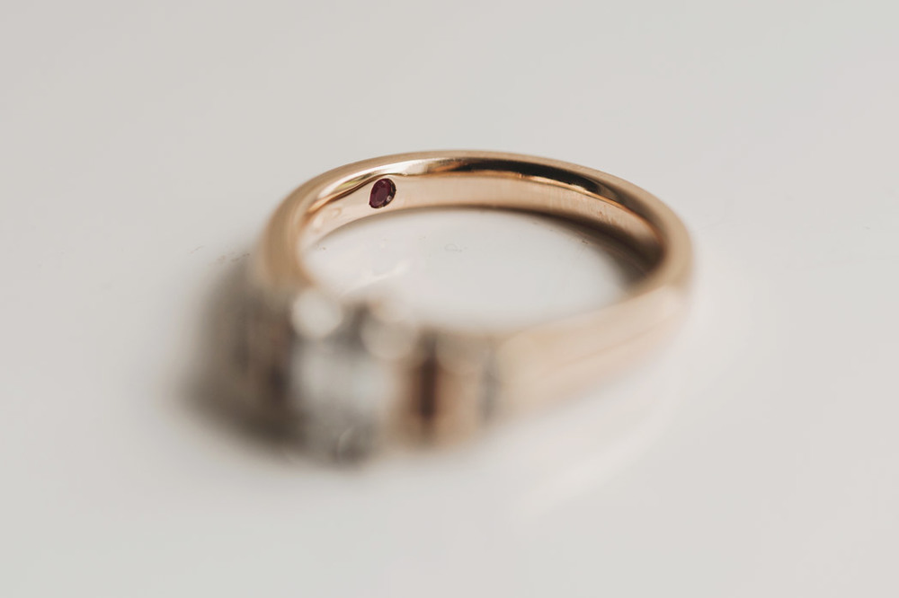Secret ruby on engagement ring - wedding photography meath