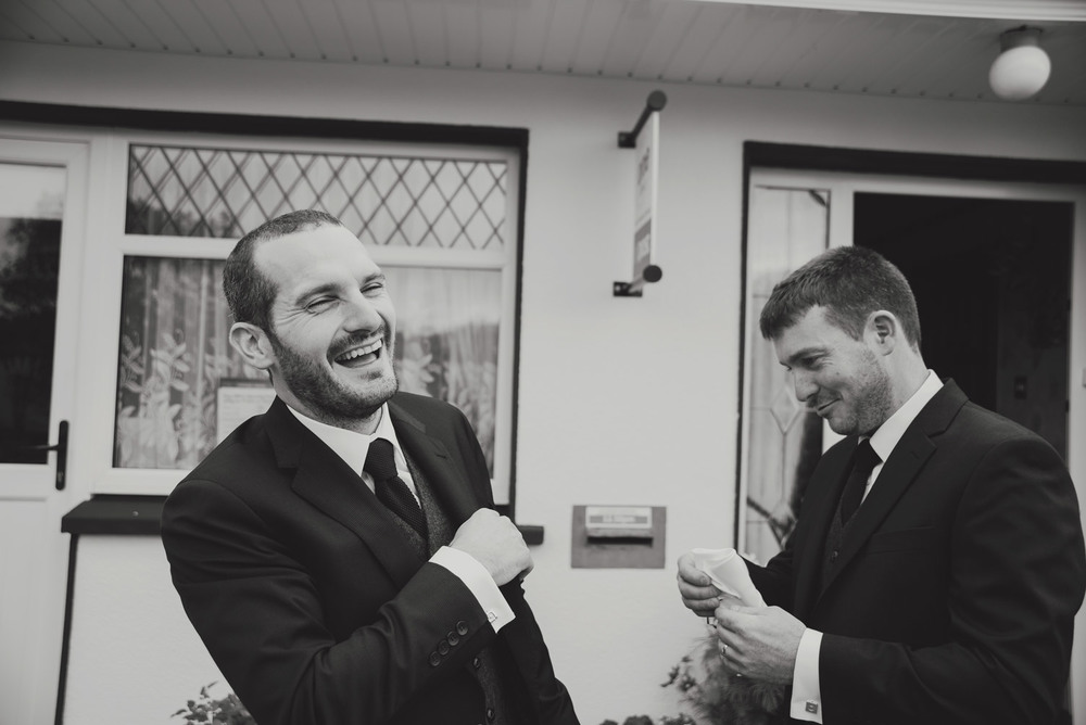 Groom and brother laughing on the morning of the wedding. Wedding photography meath