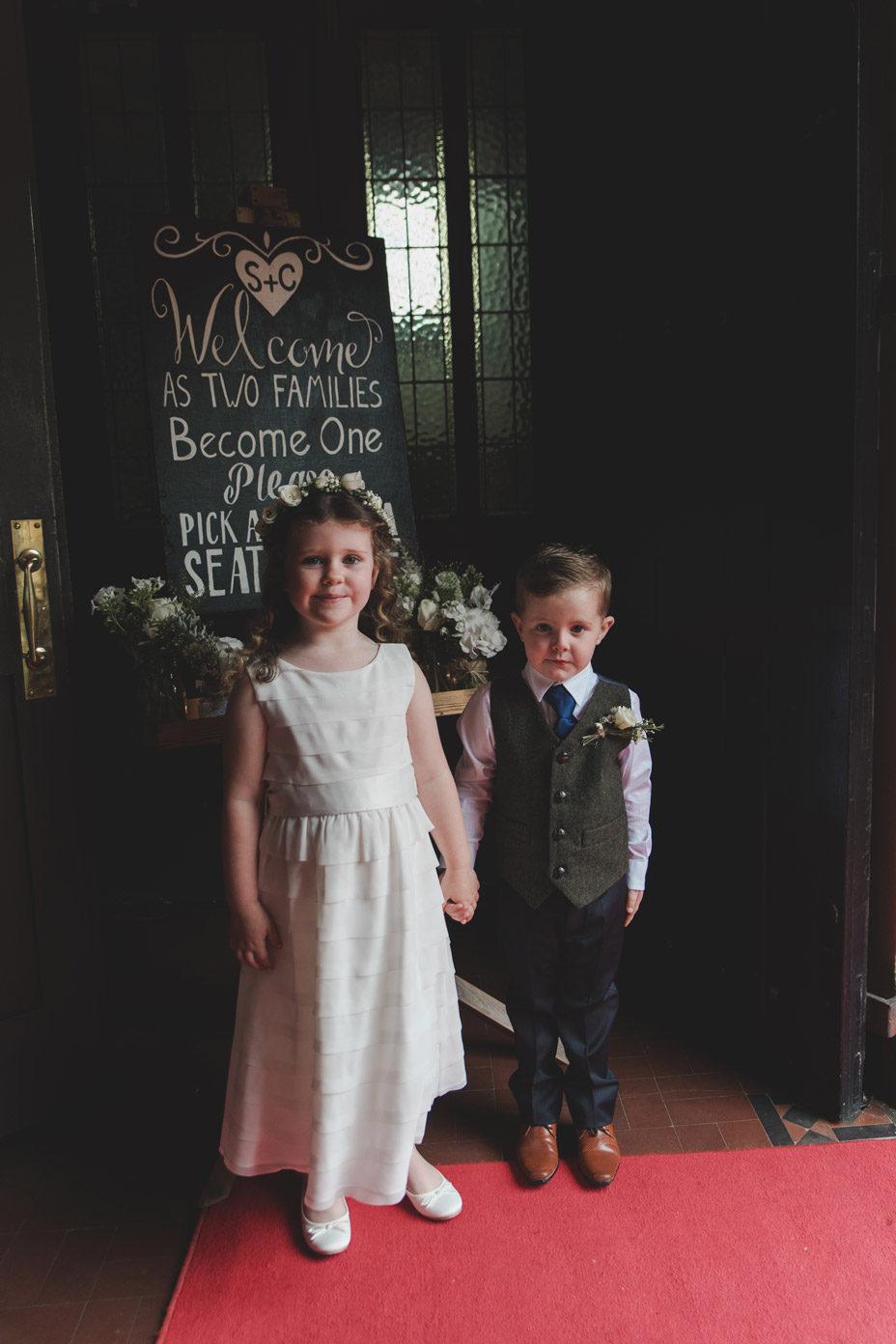 Flower girl and page boy at church entrance at Wedding in Monaghan
