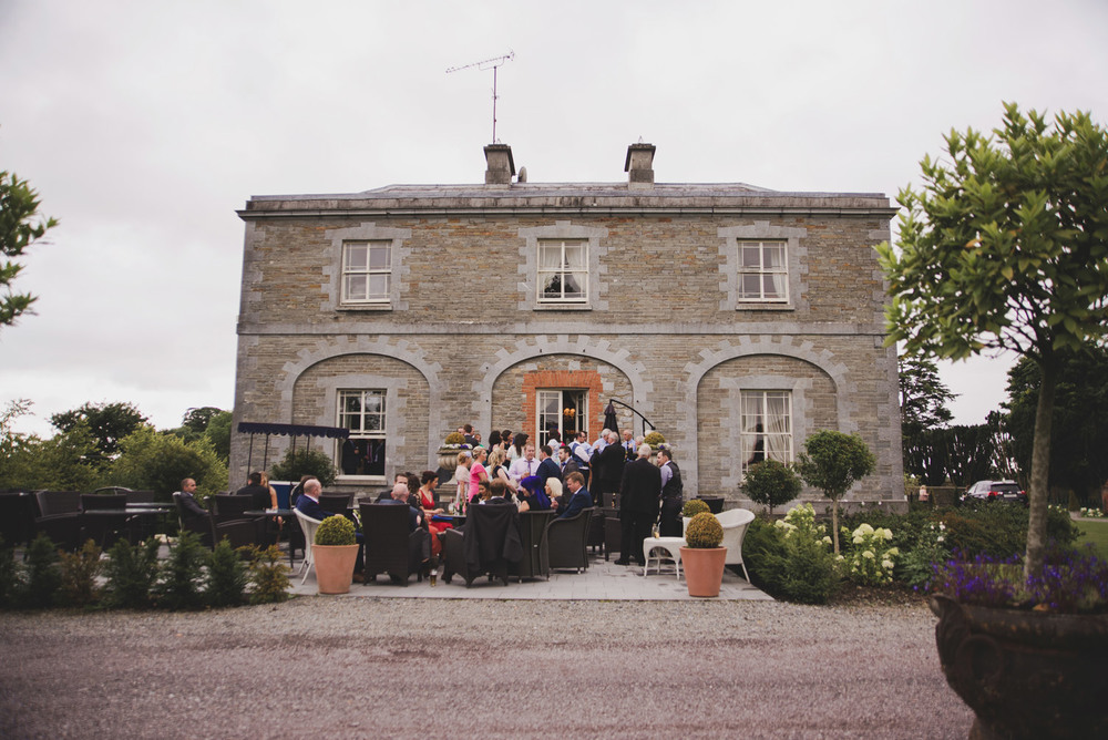 Reception and guests in Tankardstown House Meath Wedding photographers meath ireland