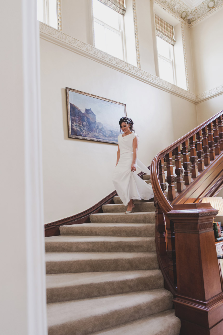 Bride coming down stairs in Tankardstown House Meath Wedding photographers meath ireland