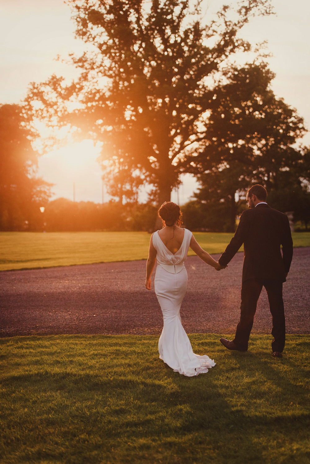 Bride and groom in sunset Tankardstown House Meath Wedding photographers meath ireland