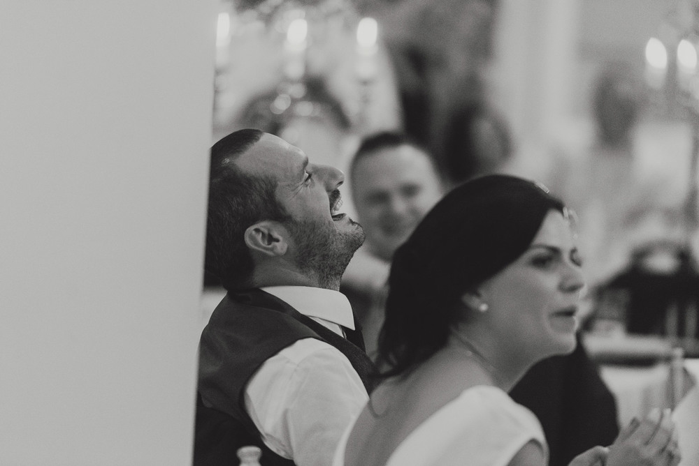 Groom laughing in Tankardstown House Meath Wedding photographers meath ireland