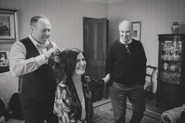 Bride getting her hair done on the morning of the wedding. Wedding photographers ireland