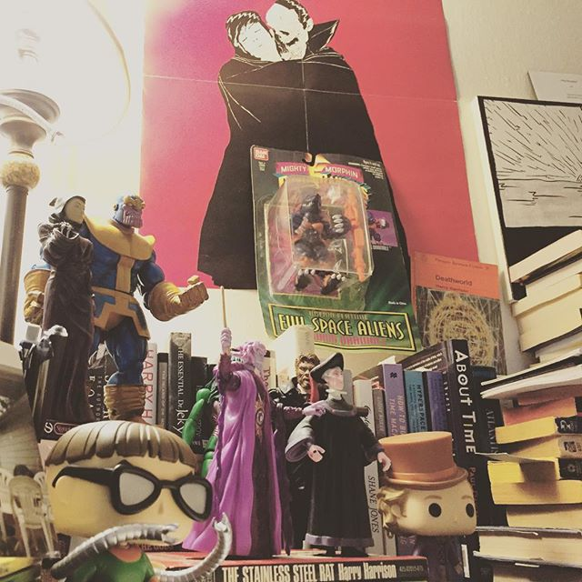 As a writer I find that surrounding myself with the characters who've left an impression on me is incredibly helpful. When struggling to write or think it's comforting to look to this diverse group of  characters and imagine how their creators brought them to life. Pictured: Ivan Ooze, Claude Frollo, Doctor Octopus, Thanos & Death, Willy Wonka, She Hulk, Mr. Hyde, and my favorite childhood action figure Dramole. Not pictured: Hagrid and Green Goblin.