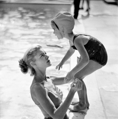 Lauren Bacall at the pool with her daughter. Photographed by Phil Stern