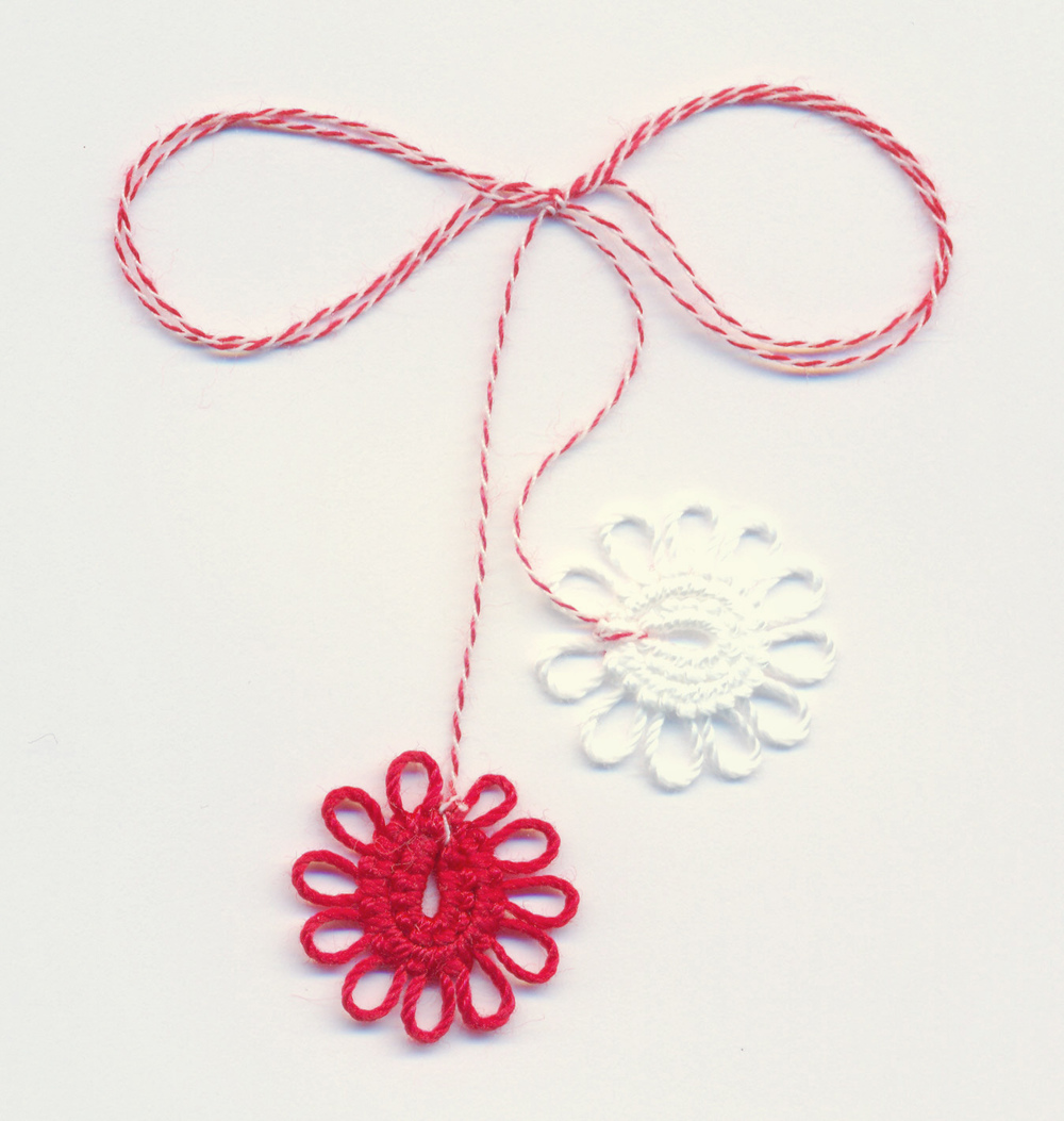 Martisor is a charm for spring time in Romanian its a traditional charm that has been around since the roman times and is said to have healing and prosperity powers.