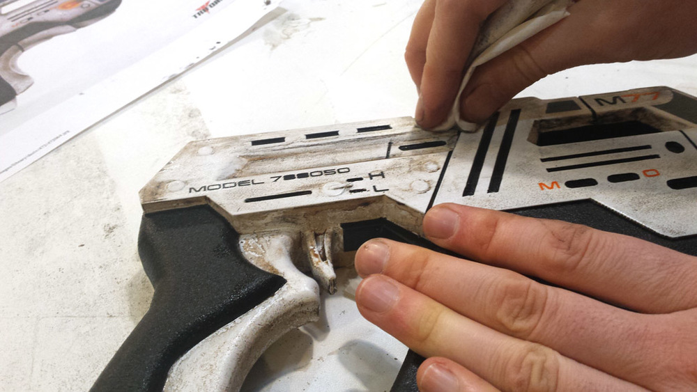 Wiping away the excess weathering on the 3D Printed Cosplay Mass Effect Pistol