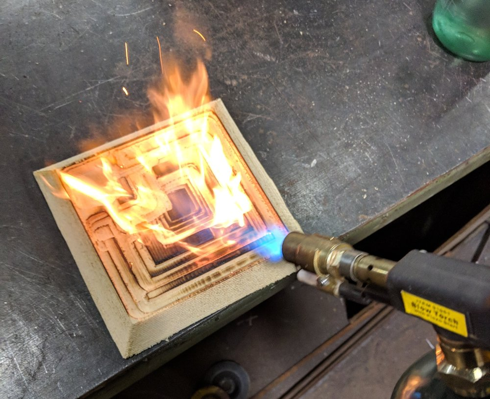 Cleaning up the Ennis House Blade Runner block mold sides using fire from a blowtorch