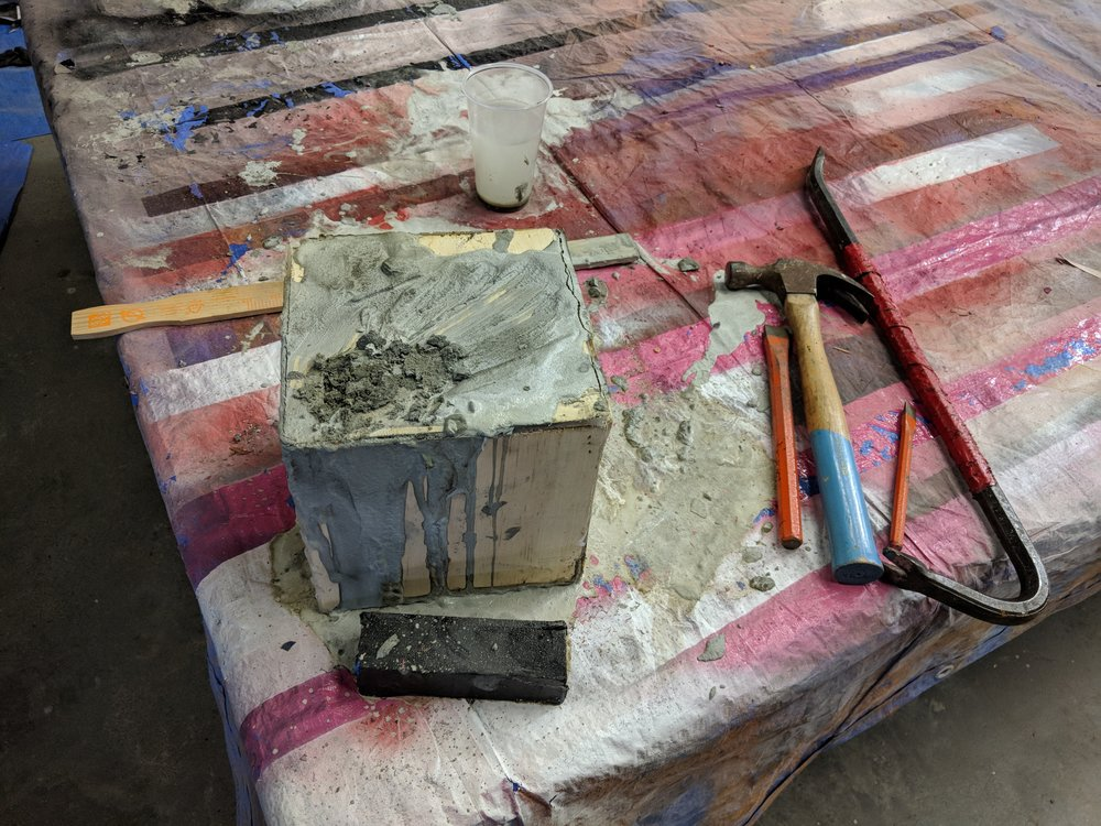 This finished mold and the tools that will be used to open it after the concrete had set for 24 hours