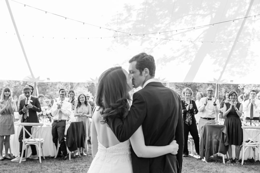 Stefy Hilmer Photograhy- bride and groom kissing in front of guests after welcoming them to their wedding.jpg
