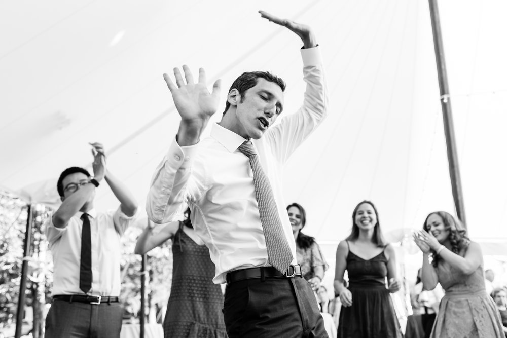 Stefy Hilmer Photograhy- groom dancing at wedding reception in a tent .jpg