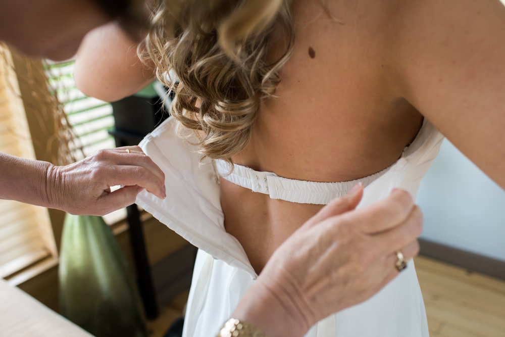 Stefy Hilmer Photography- bride is getting into her dress.jpg