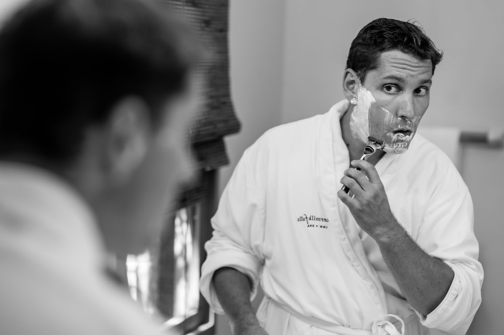 Stefy Hilmer Photography- groom is getting ready and shaving before the first look with his bride.jpg